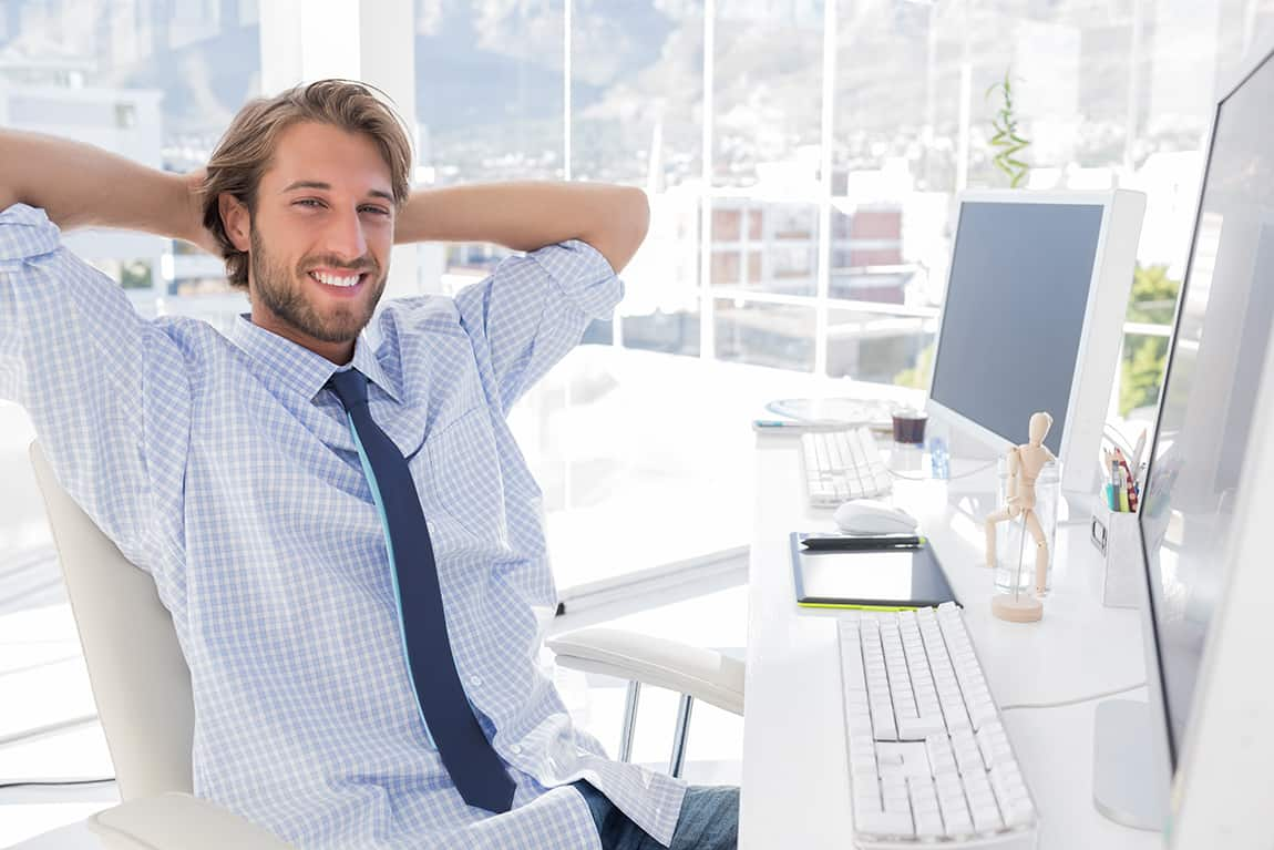 bigstock-Smiling-designer-at-his-desk-i-45846217